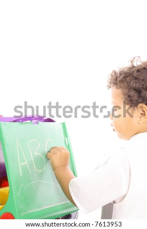 toddler writing on chalkboard vertical