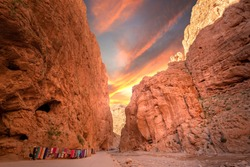 Todgha Gorge or Gorges du Toudra is a canyon in High Atlas Mountains near the town of Tinerhir, Morocco . A series of limestone river canyons, or wadi and neighbor of Dades Rivers at sunset.