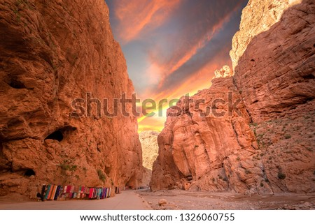 Todgha Gorge or Gorges du Toudra is a canyon in High Atlas Mountains near the town of Tinerhir, Morocco . A series of limestone river canyons, or wadi and neighbor of Dades Rivers at sunset #1326060755