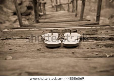 toe post sandal on old wooden...