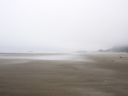 Tofino, Combers beach, in the fog - June 30/2017 - looking north.  Thick fog blends the ocean to the sky.