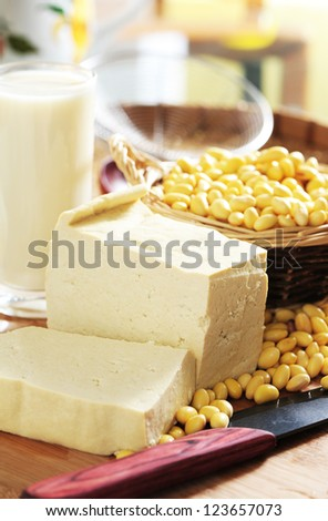 tofu and soy beans on kitchen table - stock photo