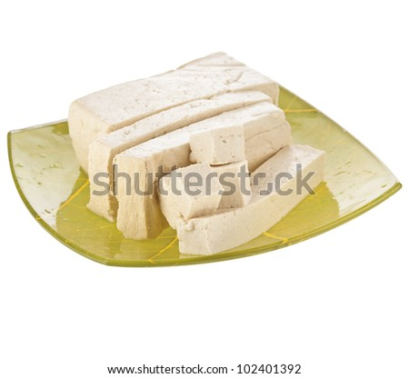 Tofu cubes on plate isolated on white