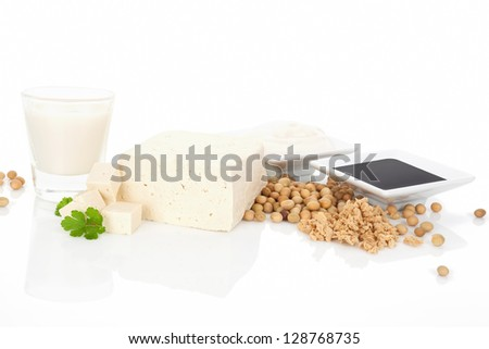 Tofu, soymilk, soybeans, soy granules, soy cream and soy sauce isolated on white background. Soy eating concept.