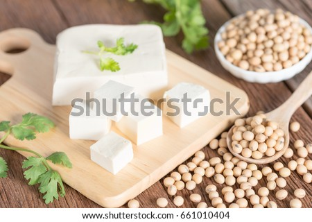 Tofu with soy bean on wooden board. Сток-фото ©