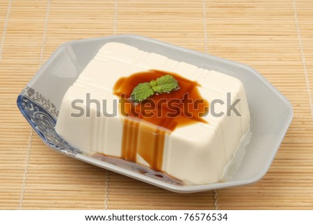 Tofu with  soya sauce on a plate
