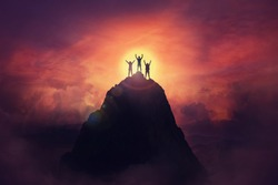 Together overcoming obstacles as a group of three people raising hands up on the top of a mountain. Celebrate victory and success over sunset background. Goal achievement symbol.