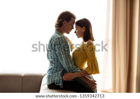 Togetherness and affection. Young couple at home