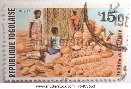 TOGO - CIRCA 1980: a 15 franc stamp from Togo shows image of a clay pot vendor, circa 1980