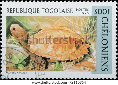 TOGO - CIRCA 1996: A stamp printed in Togo shows animal reptile turtle Puxidea mouhoti, circa 1996