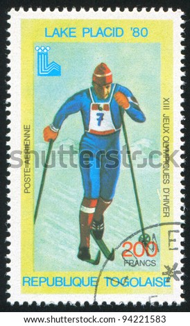 TOGO - CIRCA 1980: stamp printed by Togo, shows Cross-country skiing, circa 1980 - stock photo