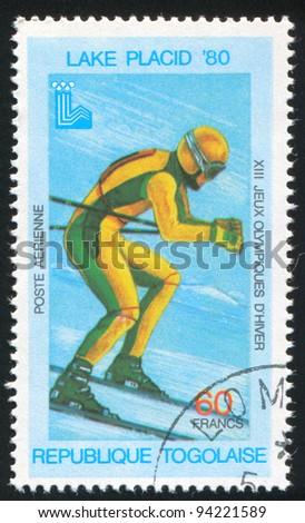 TOGO - CIRCA 1980: stamp printed by Togo, shows Downhill skiing, circa 1980