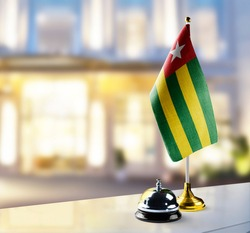 Togo flag on the reception desk in the lobby of the hotel
