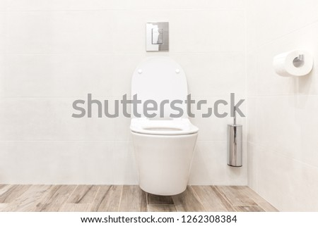 Toilet bowl in modern white style bathroom