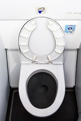Toilet bowl in the airplane.