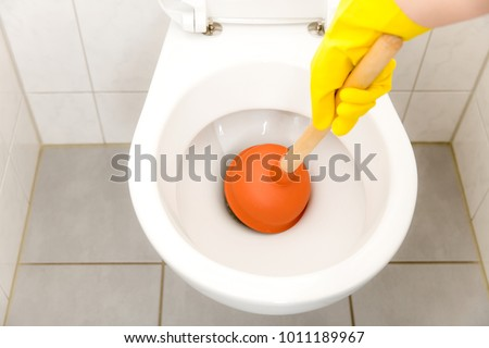 Toilet clogged - bathroom - Plunger - Shutterstock ID 1011189967