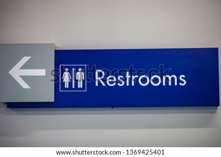 Toilet icons set. Men and women WC signs for restroom.Blue restroom sign on a  wall #1369425401
