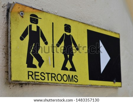 Toilet icons set. Men and women WC signs for restroom. Restroom sign on a toilet wall. #1483357130