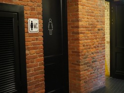 Toilet icons set. Men and women WC signs for restroom.Restroom sign on a toilet wall,on modern background.Toilet sign - Restroom Concept - black tone.