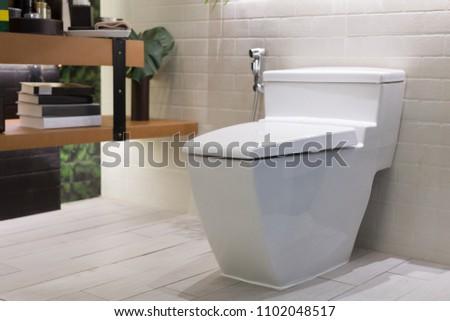 Toilet in Bathroom #1102048517