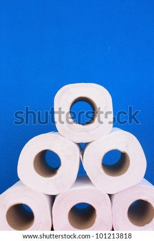 Toilet paper isolate on blue background