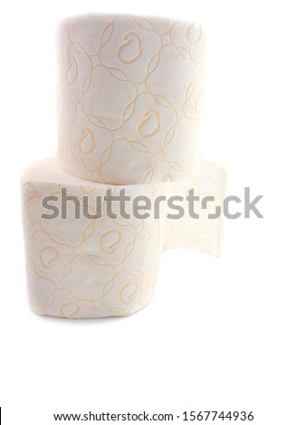 Toilet paper isolated on a white background. The composition of the rolls of toilet paper. Toilet paper with a pattern. Set of toilet paper. #1567744936