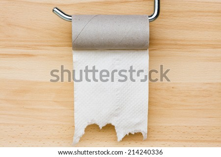 Toilet paper on wooden background. Empty space for text #214240336