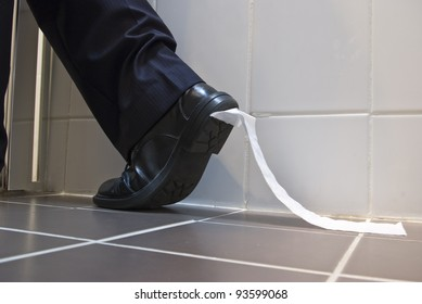 A stock photo of toilet paper stuck to the sole of a dress shoe