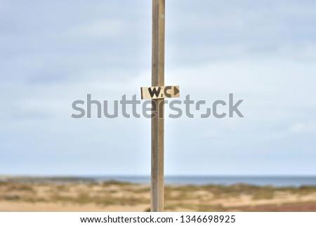 toilet pointer on the beach #1346698925