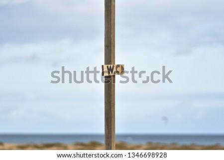 toilet pointer on the beach #1346698928