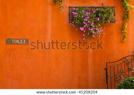 Toilet sign and flower box