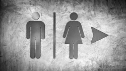 Toilet sign on mortar wall - grunge black and white