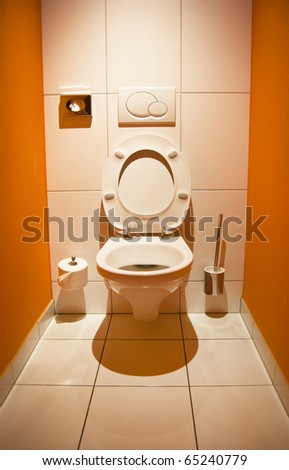 Toilet with an open lid and romantic lighting