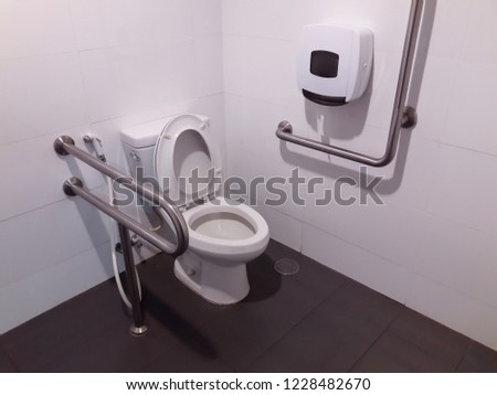 Toilet with friendly design for people with disability. public toilet in a large building of the office building. #1228482670