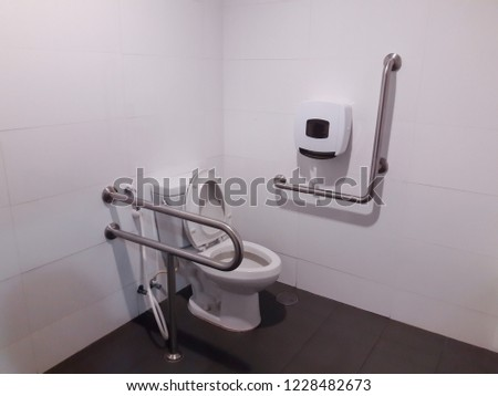 Toilet with friendly design for people with disability. public toilet in a large building of the office building. #1228482673