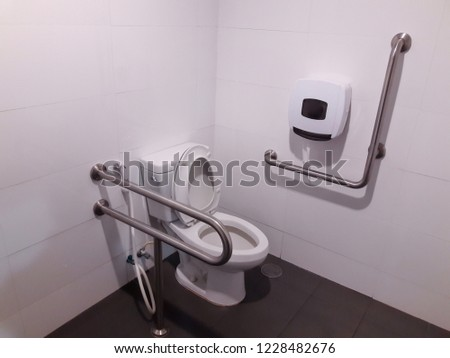 Toilet with friendly design for people with disability. public toilet in a large building of the office building. #1228482676