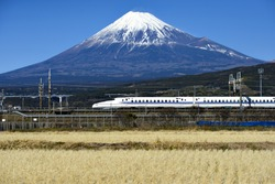 Tokaido Shinkansen and Fuji mountain with rice field