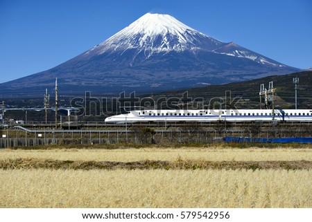 Tokaido Shinkansen and Fuji mountain with rice field #579542956