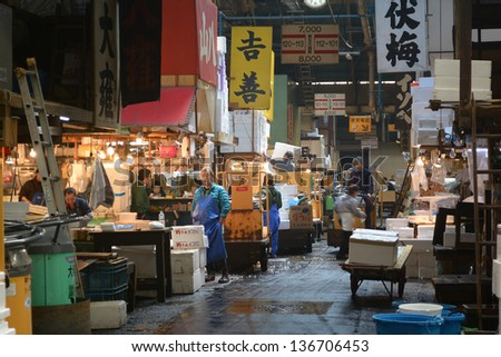 TOKYO - APRIL 5 : Fish seller at Tsukiji Market, the biggest wholesale market in Japan, market will be moved to new location in 2014, April 5, 2013 in Tokyo, Japan.
