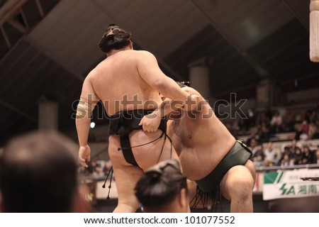 TOKYO - APRIL 7: Unidentified sumo wrestlers in a tournament on April 7, 2012 in Tokyo, Japan. Even though Sumo is Japan's national sport, most professional wrestlers are foreigners #101077552