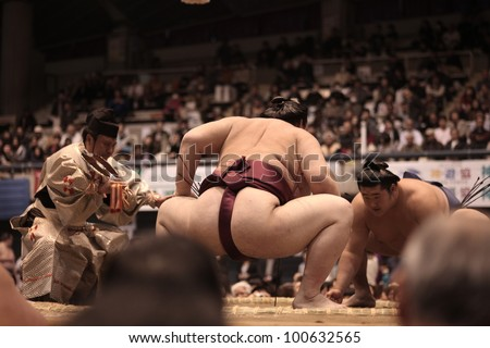 TOKYO - APRIL 7: Unidentified Sumo wrestlers in the Fujisawa tournament in Tokyo, Japan on April 7, 2012. Even though the sport is mostly dominated by foreigners it is still Japan's national sport. #100632565