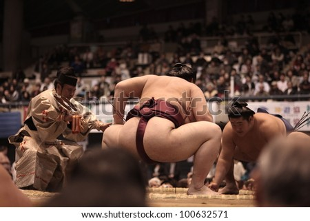 TOKYO - APRIL 7: Unidentified Sumo wrestlers in the Fujisawa tournament in Tokyo, Japan on April 7, 2012. Even though the sport is mostly dominated by foreigners it is still Japan's national sport. #100632571