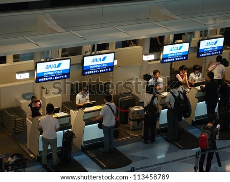 TOKYO - AUGUST 2: All Nippon Airways (ANA) check in counter on August 2, 2012 at Tokyo International Airport, Tokyo. ANA is Japan's largest airline.
