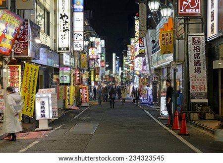 TOKYO CIRCA NOVEMBER 2014 Despite reports of a slowing Japanese economy the neon lights of Shinjuku reflect a vibrant hub of retail and commercial business restaurants and entertainment