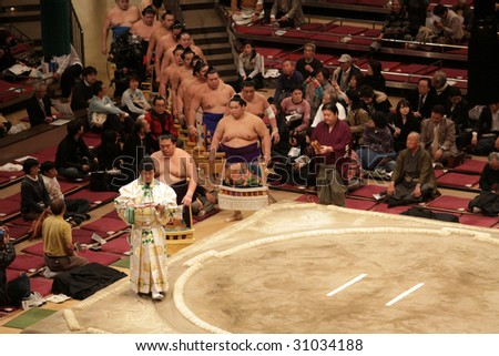TOKYO - JANUARY 21: High rank sumo wrestlers entering arena after priest in the Tokyo Grand Sumo Tournament January 21, 2009 in Tokyo, Japan. - stock photo