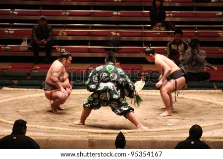 TOKYO - JANUARY 14: Unidentified wrestlers in the Grand Sumo Tournament in Tokyo, Japan on January 14, 2012. Although baseball has surpassed sumo in viewers, it is still Japan\'s national sport