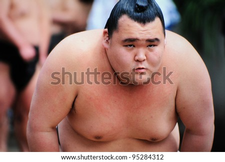 TOKYO JAPAN - APRIL 11 : An unidentified Sumo wrestler competes in Yasukuni Shrine during the sumo spring tournament on April 11, 2007 in Tokyo, Japan