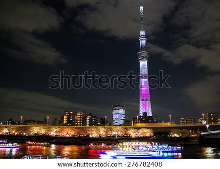 TOKYO,JAPAN-APRIL 2 :Tokyo sky tree  in the night view beside the river in Tokyo,Japan  on  April 2,2015.Toky sky tree is the tallest building in Japan.