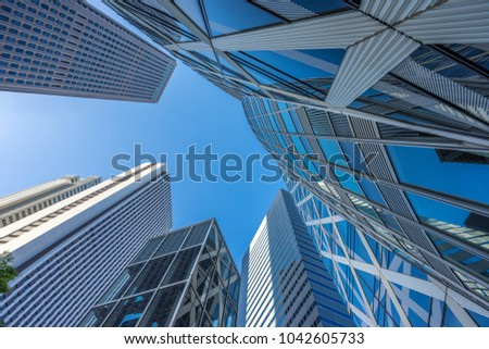 Tokyo, Japan - August 31, 2016: Street level view of High Rise buildings around Mode Gakuen Cocoon Tower educational facility located in the Nishi-Shinjuku district #1042605733