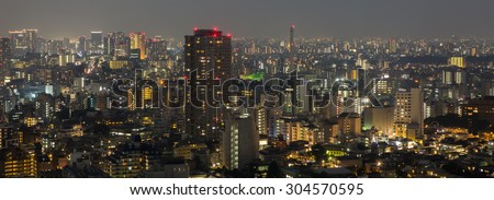 TOKYO, JAPAN - AUGUST 8TH, 2014: View of Tokyo metropolis at night . Tokyo is one of the 47 prefecture of Japan and is the capital of Japan. it is also Japan\'s largest city.